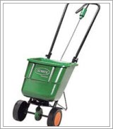 A manually pulled lawn feed spreader